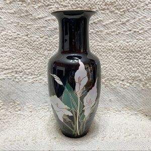 Vintage black vase with white calla lily flowers